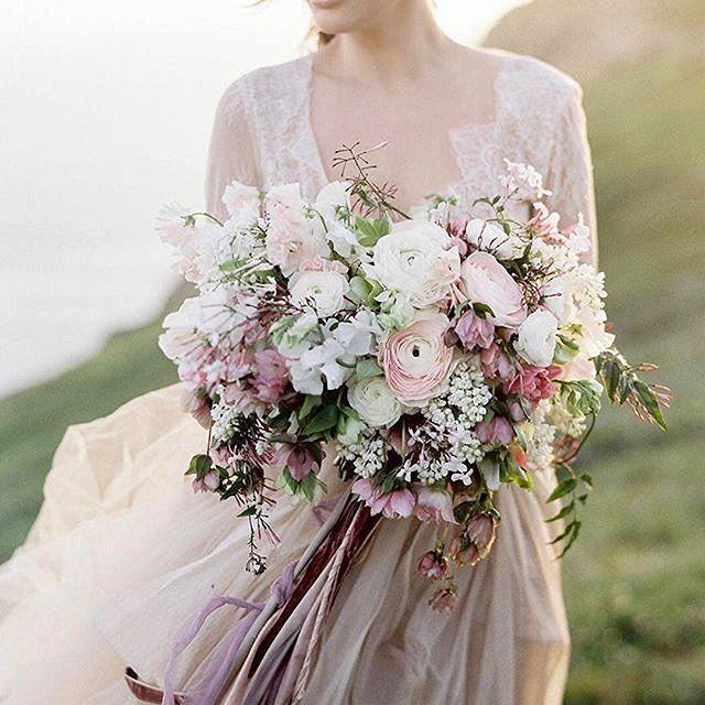 LOVE! /vofloraldesign/'s beautiful bouquet is so inspirational for this wedding season! Photo: @tylerrye_ | Stylist @cali_smittenkiss | Dress: /clairelafaye/ | Silks: /thepoetryofsilk/ | HMUA @facesbyemily | Models /melissaziegler/ + @kellen_lehman