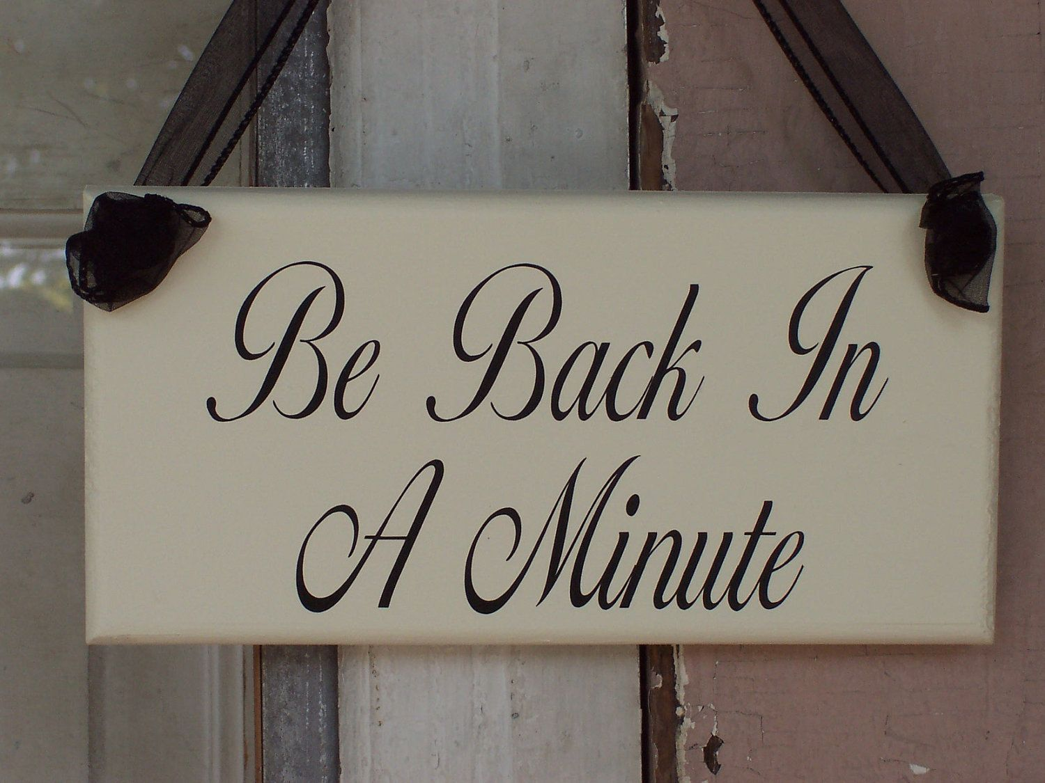 Whimsical Shabby Cottage Wood Vinyl Sign With Ribbon -Be Back In A Minute. $16.99, via Etsy.