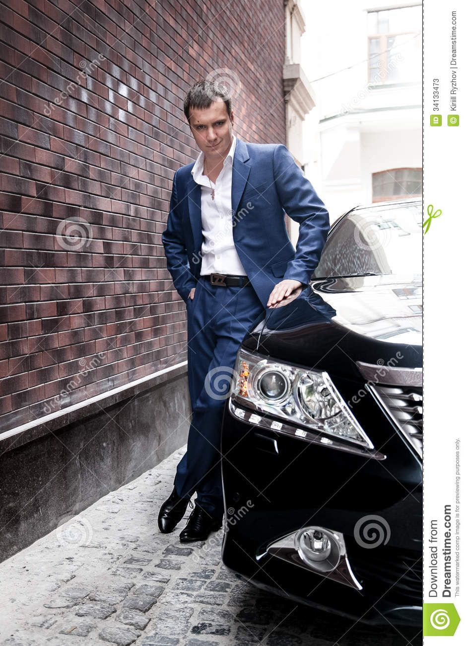 Man In Suit Posing Near Car Poses Men Photography Mens Suits