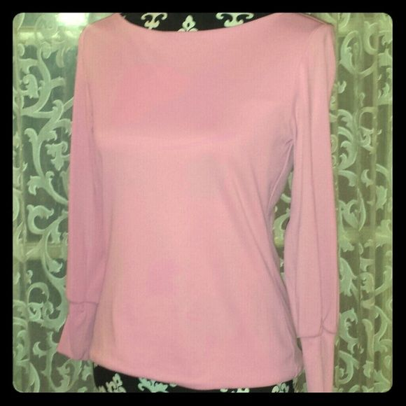 LOVE this top!!! Very soft pink jersey material. This is a beautiful top. You will love. Tops
