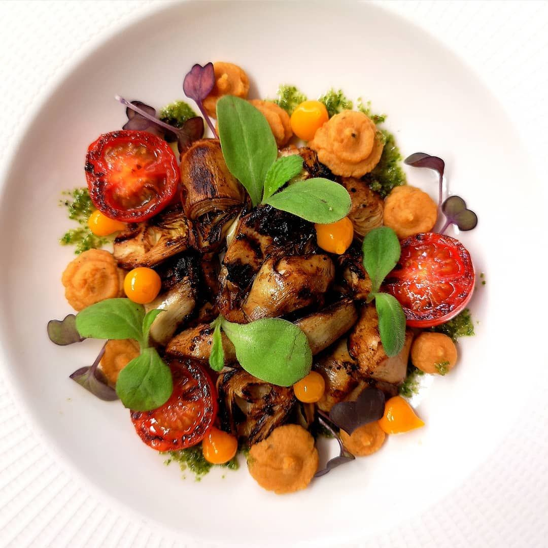 Pan fried whisky artichoke, chickpeas puree, burnt cherry tomato and micro greens...