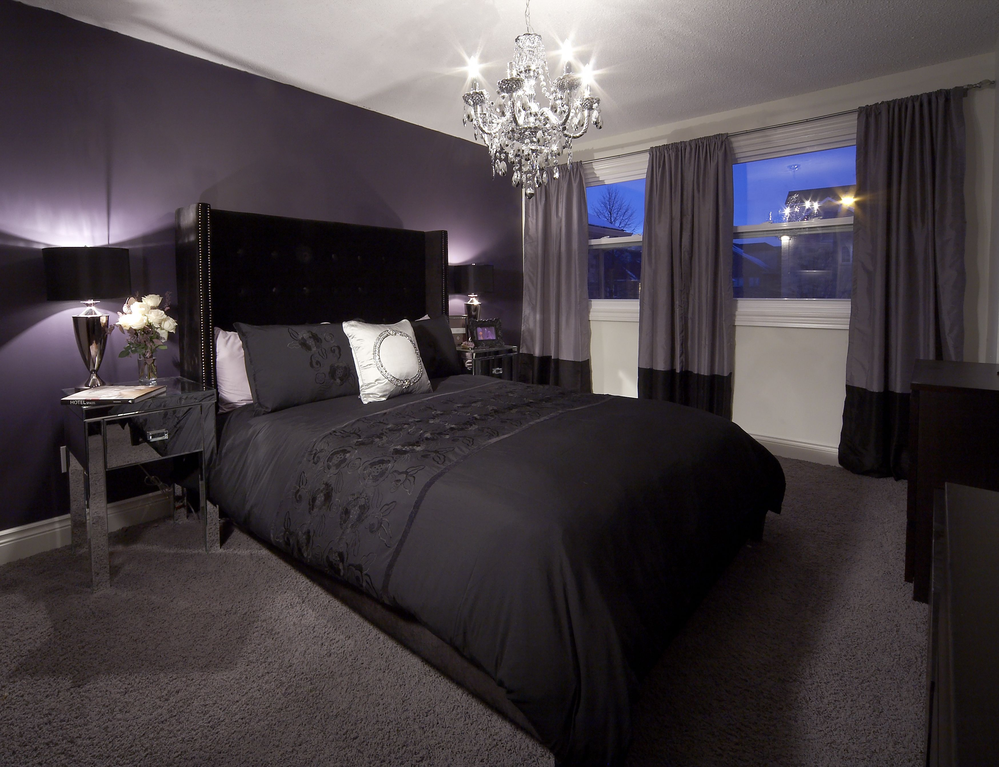 Bedroom with purple feature wall and drapery, crystal ...