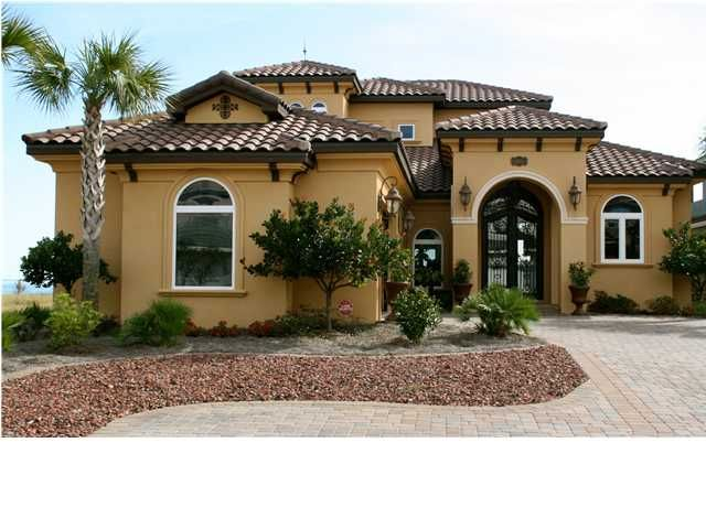 Custom designed mediterranean home with 11 39 wrought iron for Mediterranean stucco