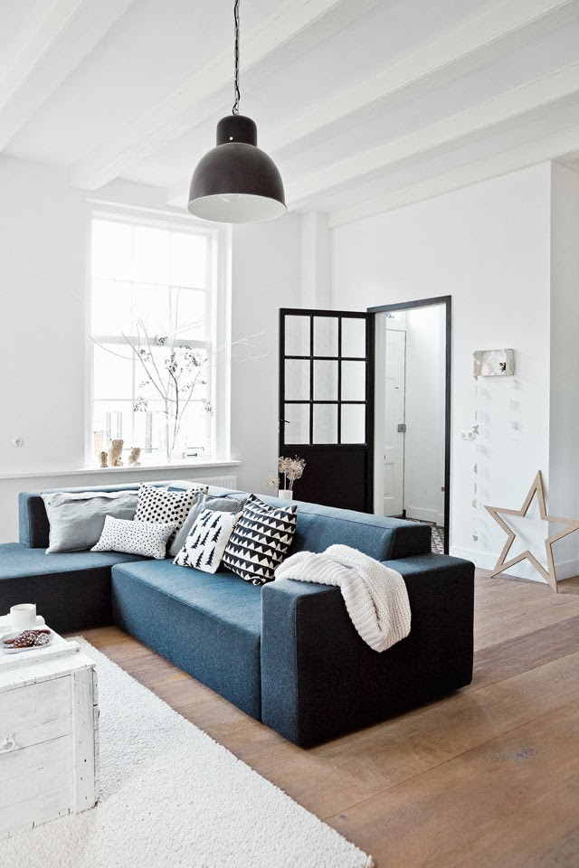 Living Room In White And Wood With A Dark Blue Sofa By Kim Van Rossenberg