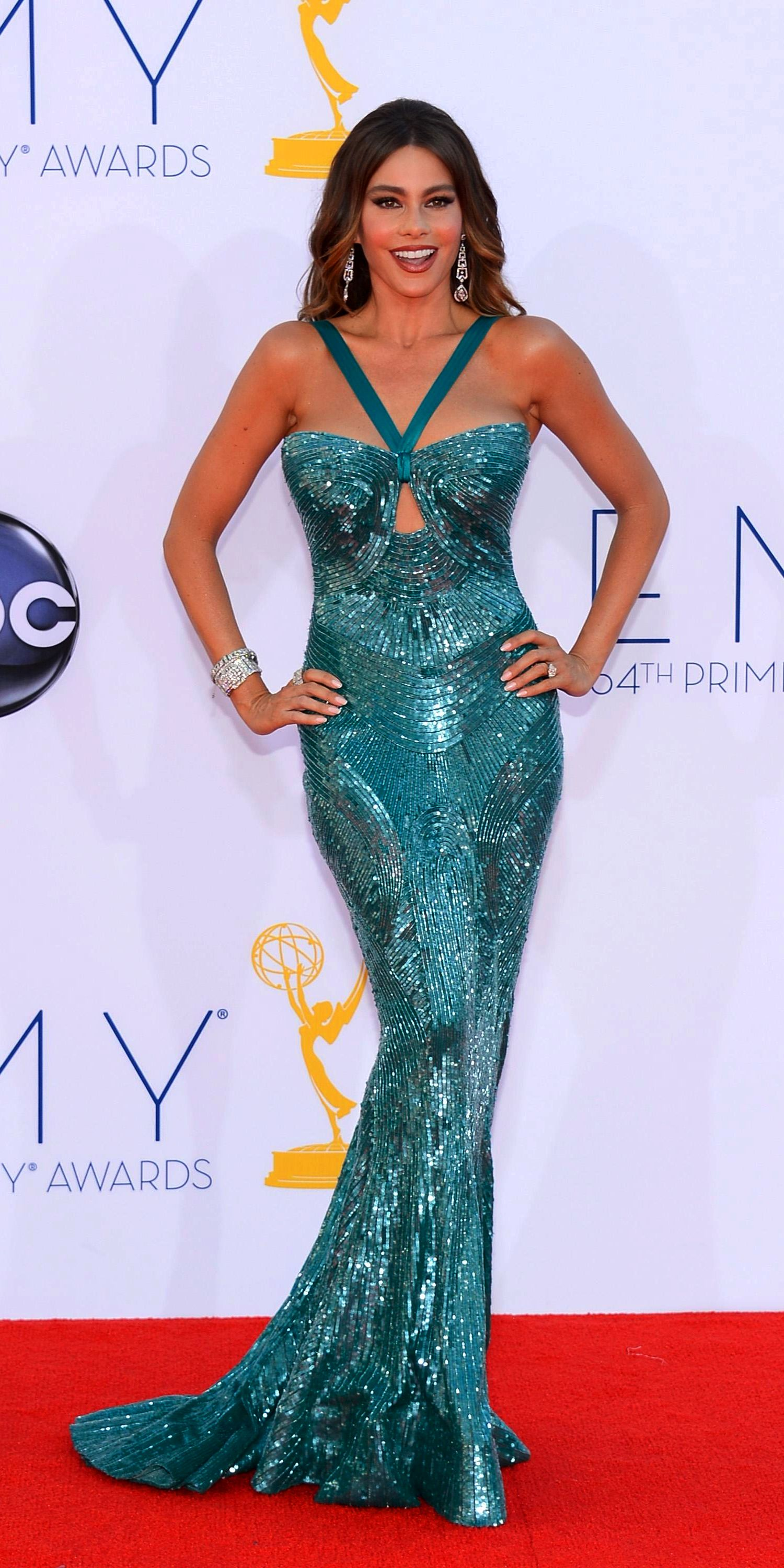 40 years old Sofia Vergara is still hot and sexy in a teal Zuhair ...