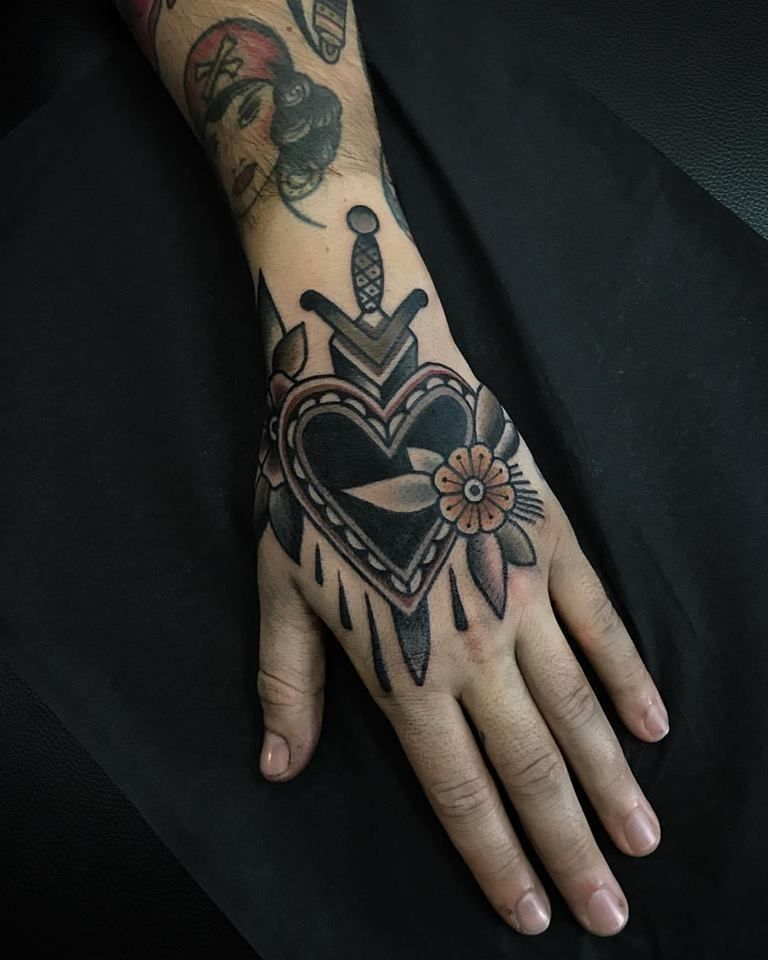 Traditional tattoo of a black heart, dagger, and flower inked on the left hand -  Traditional tattoo of a black heart, dagger, and flower inked on the left hand  - #black #cattatto #coupletatto #dagger #flower #Hand #heart #inked #left #shouldertatto #snaketatto #tattoantebrazo #tattohombre #tattosketches #tattoo #traditional #traditionaltatto
