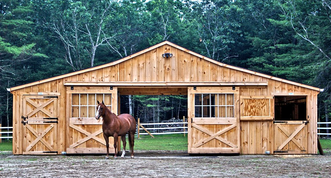 Cedar board and batten low profile modular barn completed for Small horse barn plans