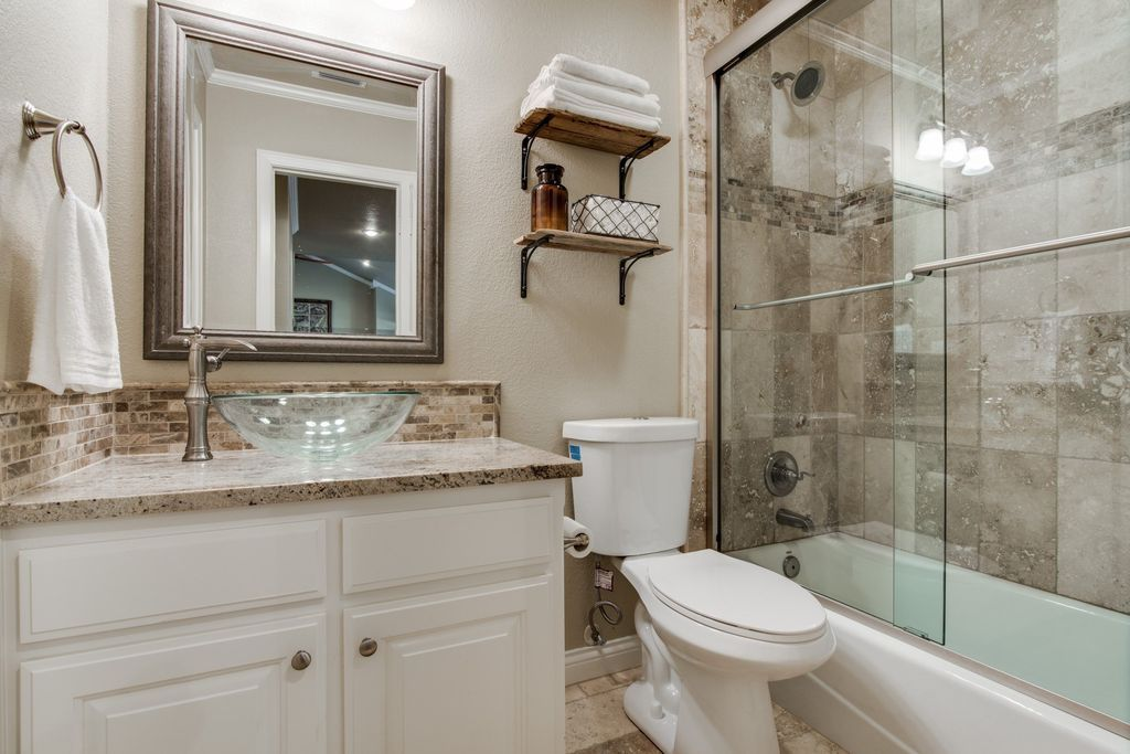 Traditional Full Bathroom With Crown Molding Tiled Wall Showerbath