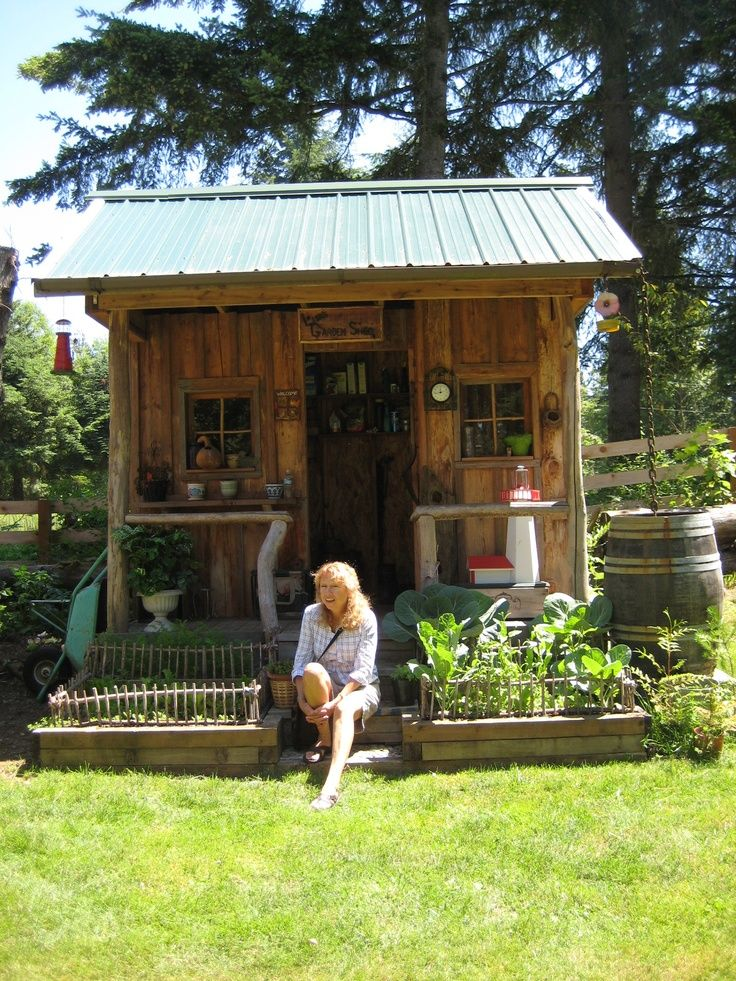 Decorated Sheds With Porch Sitting In Front Of A
