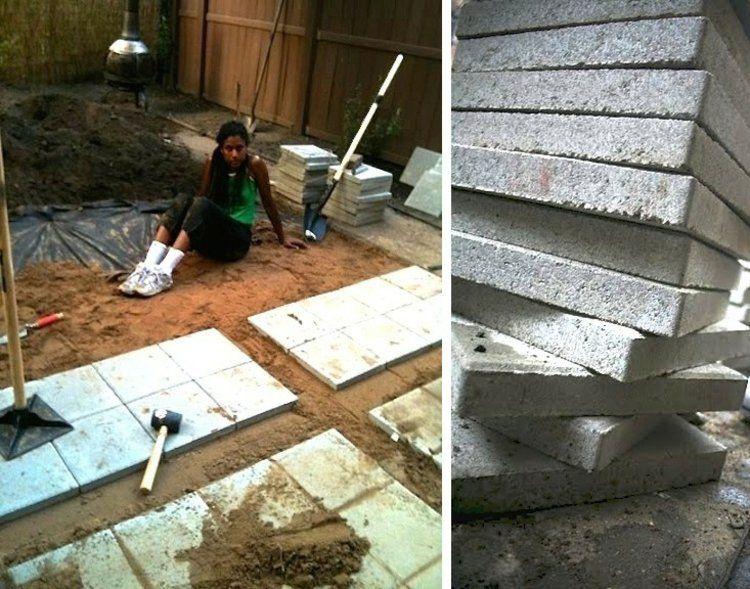 pose de dalles de béton gris sur sable pour créer une terrasse de - pose dalle terrasse sur beton