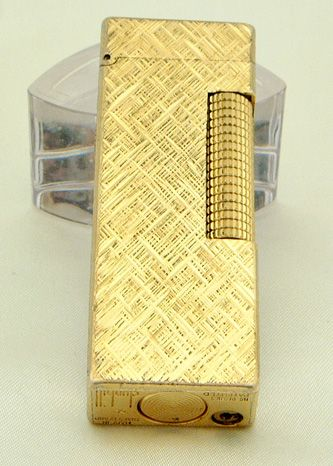 Dunhill gold lighter,,his staple with those More long brown