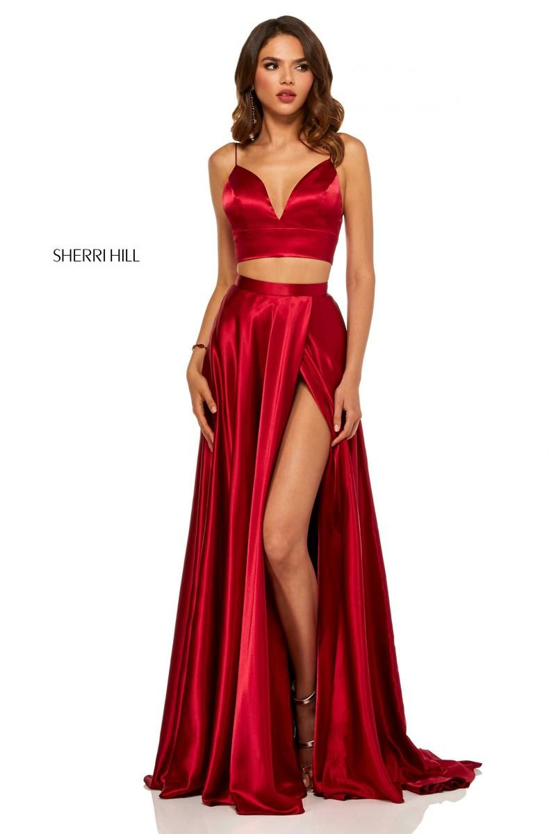 06402ff931a Style 52488 from Sherri Hill is a deep sweetheart spaghetti strap 2 piece  prom gown with a tie back and a high slit in the draped skirt.