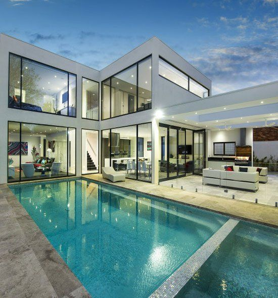 Contemporary House Architecture With A Cool Pool Big Windows And