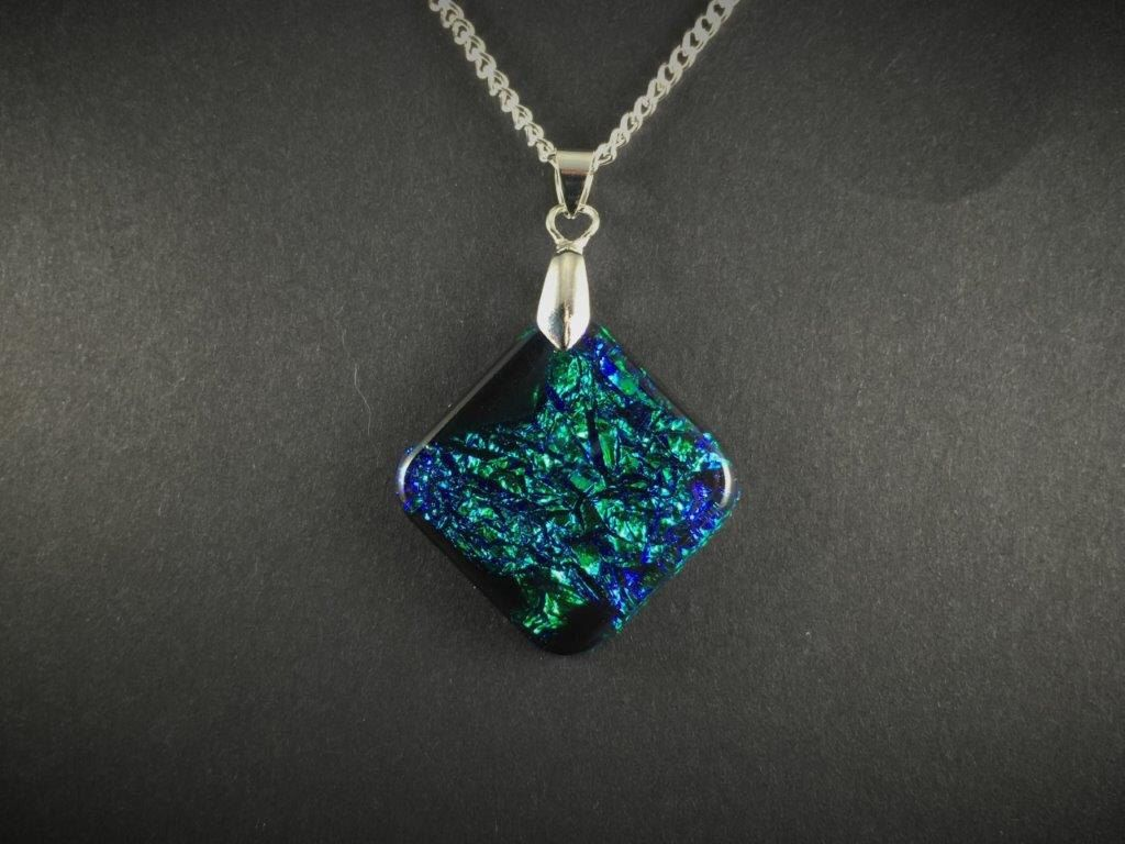A personal favorite from my Etsy shop https://www.etsy.com/listing/287680539/blue-green-dichroic-resin-pendant