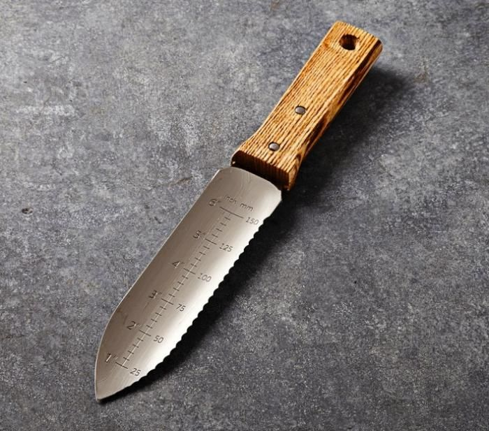 The Stainless Steel Hori Hori Knife is also fantastic for sawing, trimming, cutting, and transplanting in the garden. The two-sided blade on this Japanese gardening tool has a straight edge for weeding and cultivating, and a serrated edge for cutting roots, dividing plants, and trimming branches. Handmade at a 50-year-old workshop in Japan, it comes with a non-leather sheath;