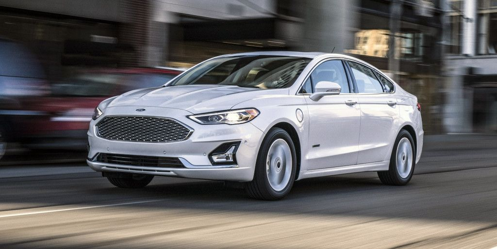 The Redesigned 2019 Ford Fusion Was Unveiled Tuesday With Mildly Updated Styling Front And Rear The New Co Pilot360 S Ford Fusion Ford Fusion Energi 2019 Ford