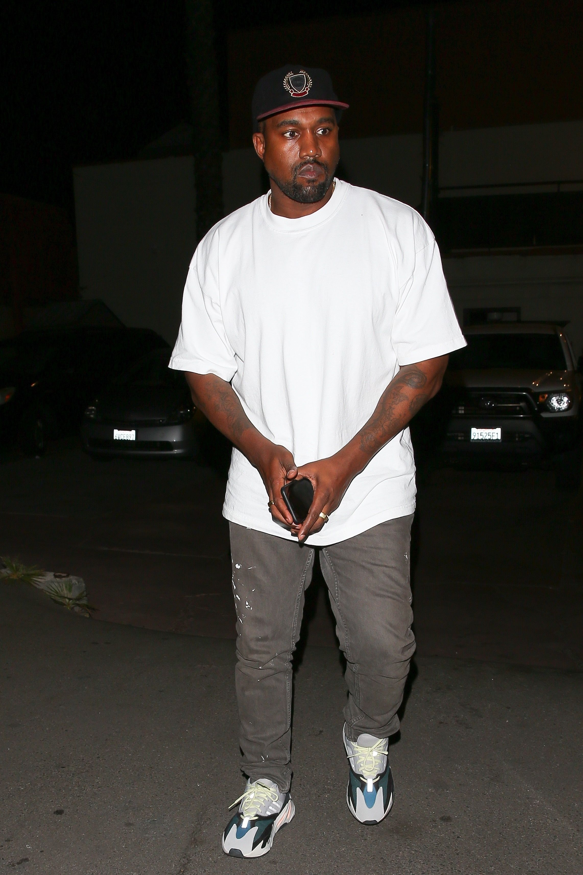 2cf5725e5 Kanye West wearing Yeezy Season 5 Crest Hat, Adidas Yeezy Wave Runner 700,  Helmut Lang Painter Jeans