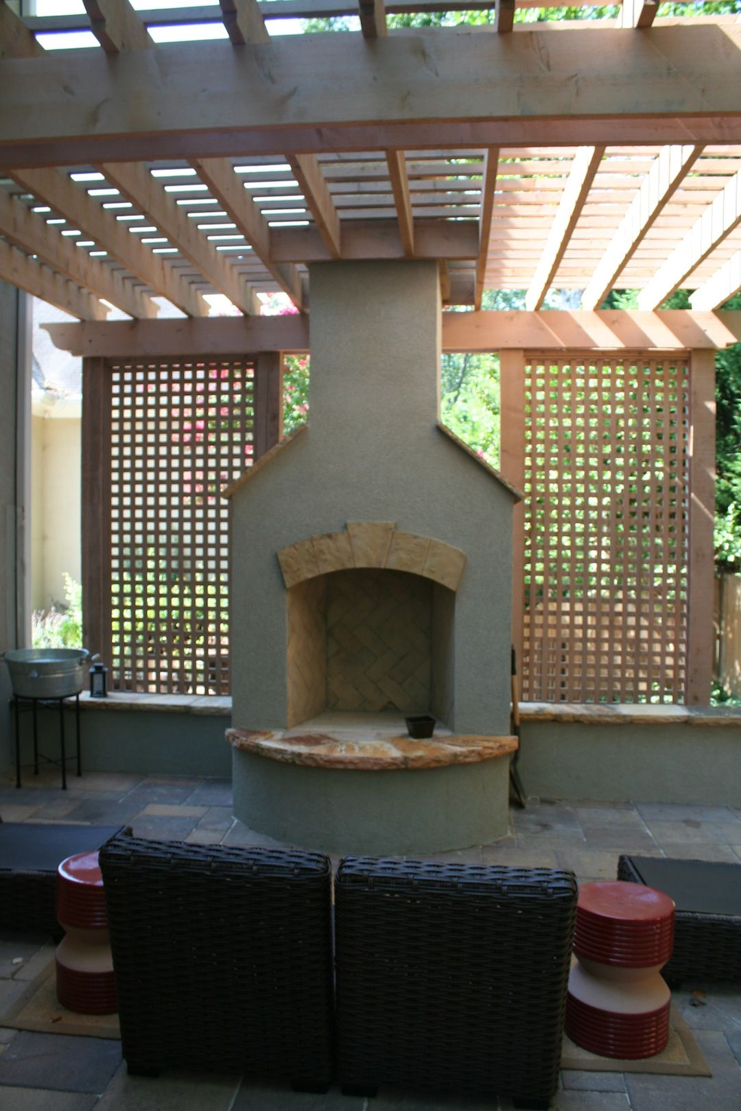 Stucco Fireplace With Cedar Pergola And Lattice Walls