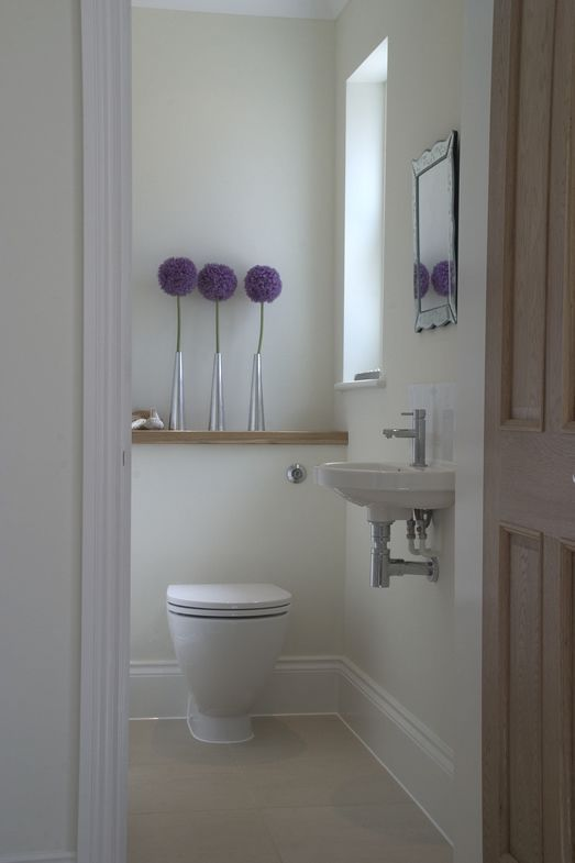 Wooden elements This cloakroom uses wooden elements to beautiful effect.  The slick oak shelving is