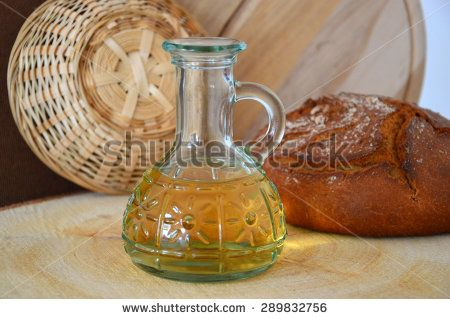 a bottle of vegetable oil, bread - stock photo