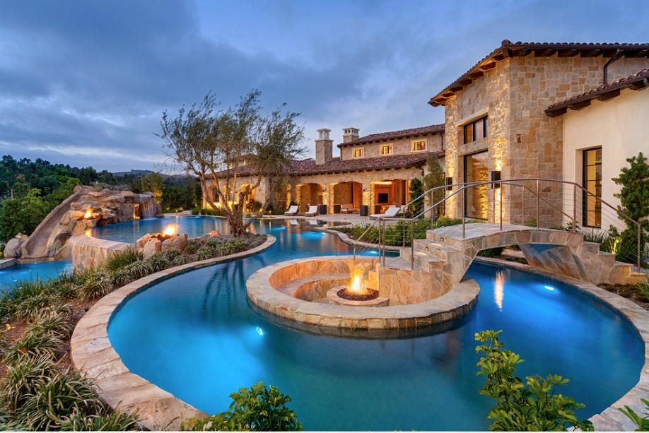 Having a house with a lazy river and sunken firepit!  http://georgiapapadon.com/