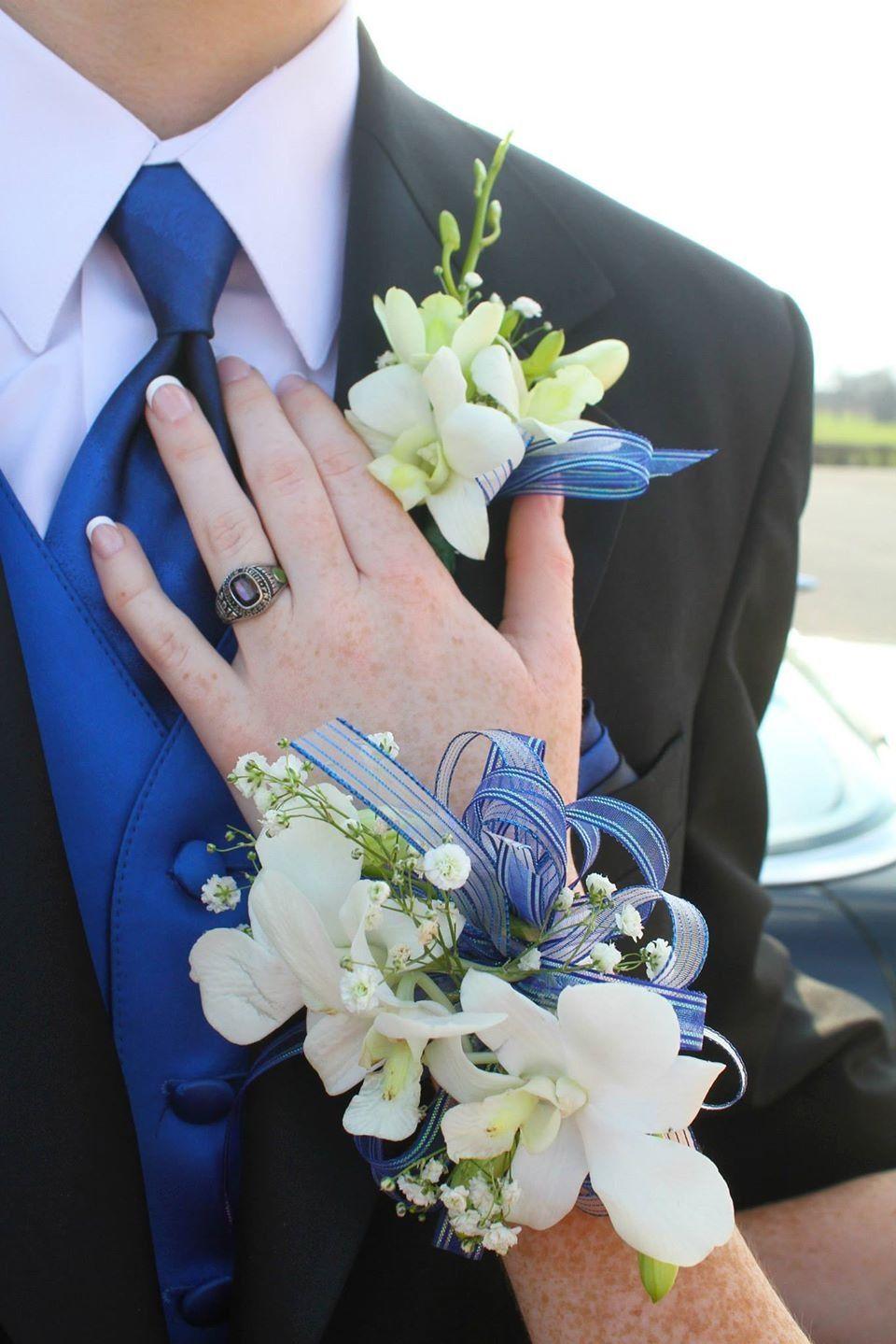 Couples pose prom formaldance corsage