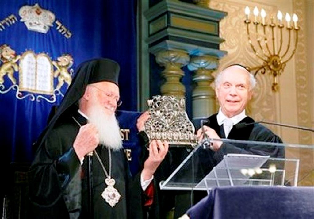 In this photo from Appeal of Conscience Foundation, Rabbi Arthur Schneier, right, senior Rabbi of the Park East Synagogue, presents Ecumenical Patriarch Bartholomew a menorah, during his visit to the Park East Synagogue in New York, Wednesday, Oct. 28, 2009. This is the Istanbul-based patriarch's only visit to a Jewish house of worship during his 18-day Apostolic Visit to the United States.