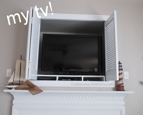 So What Is Exactly Is Behind The White Shutters On My Mantel White Shutters Hanging Tv Tv Decor