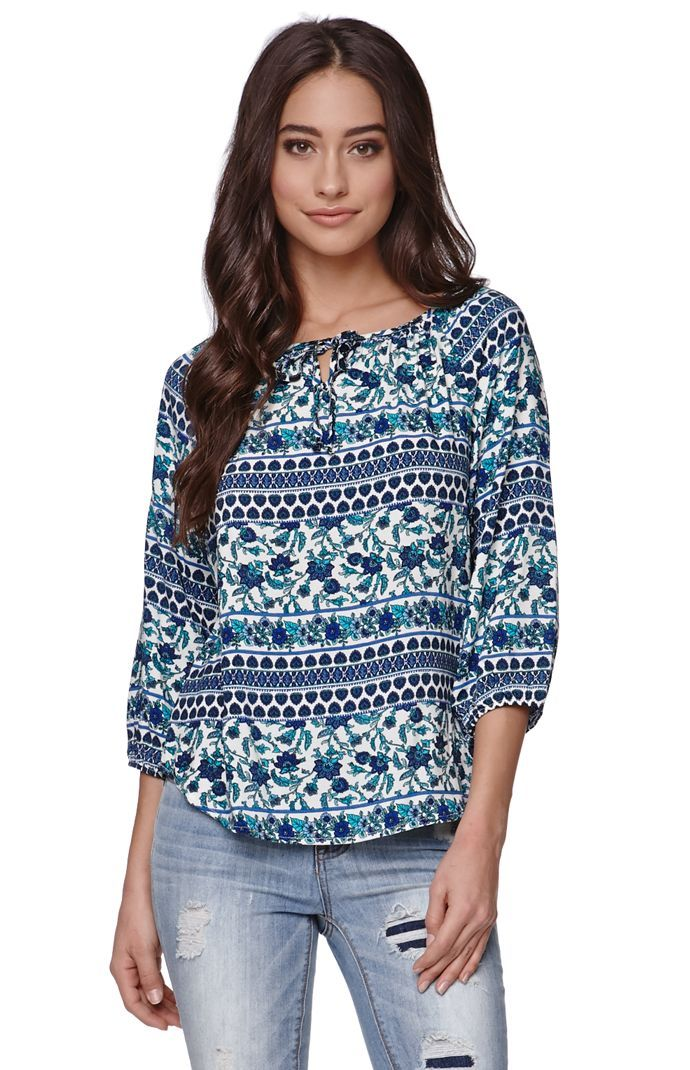 """A PacSun.com Online Exclusive!The women'sBorder Peasant Top by LA Hearts for PacSun.com offers a bold print throughout and tie front detail. We love the relaxed fit and soft fabric. Wear this top with our skinniest jeans and stylish boots!24""""length17"""" sleeve lengthMeasured from a size smallModel is 5'9"""" and wearing a small100% rayonMachine washableMade in USA"""