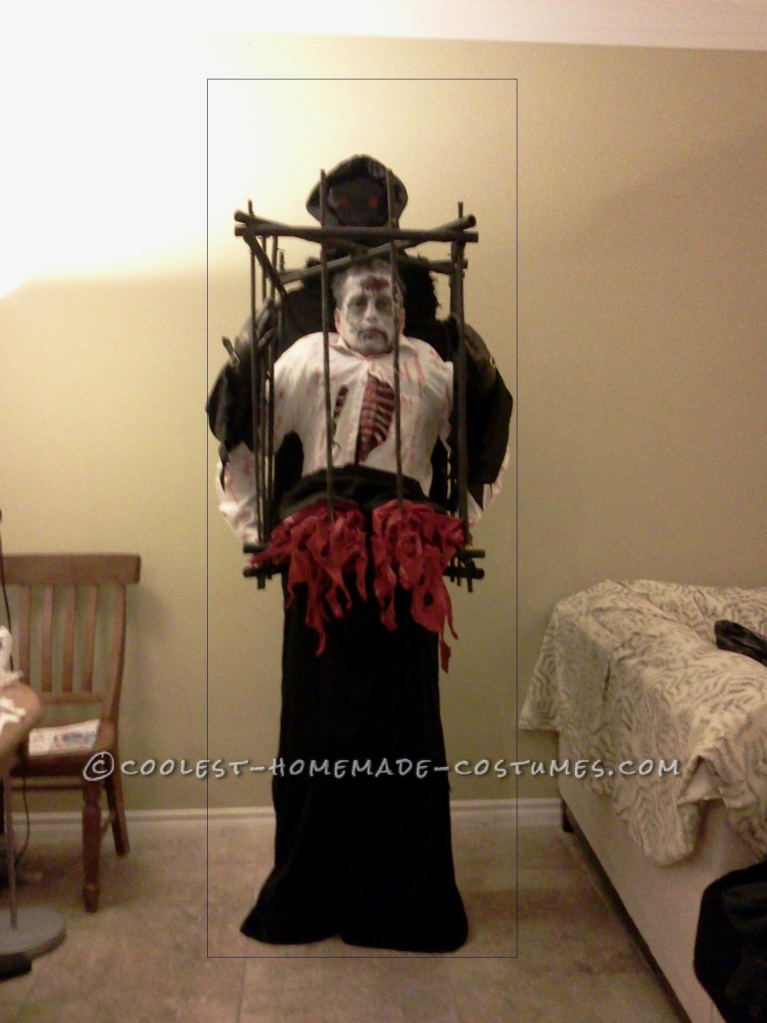 Grim Reaper with Half Zombie in a Cage Illusion Costume ...  Grim Reaper wit...