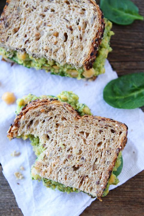 Smashed Chickpea, Avocado, and Pesto Salad Sandwich Recipe #vegan - on twopeasandtheirpod.com My favorite sandwich! You have to try this one!