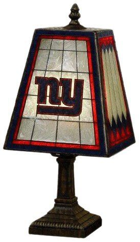 NFL New York Giants 14 Inch Art Glass Lamp by The Memory Company. $44.99. Made of Hand-Painted Art Glass. Takes a 40 Watt G16.5 style Bulb. Bulb not included. Team logos on two sides. 14.5tall by 7 3/8 wide. NFL New York Giants 14 Inch Art Glass Lamp