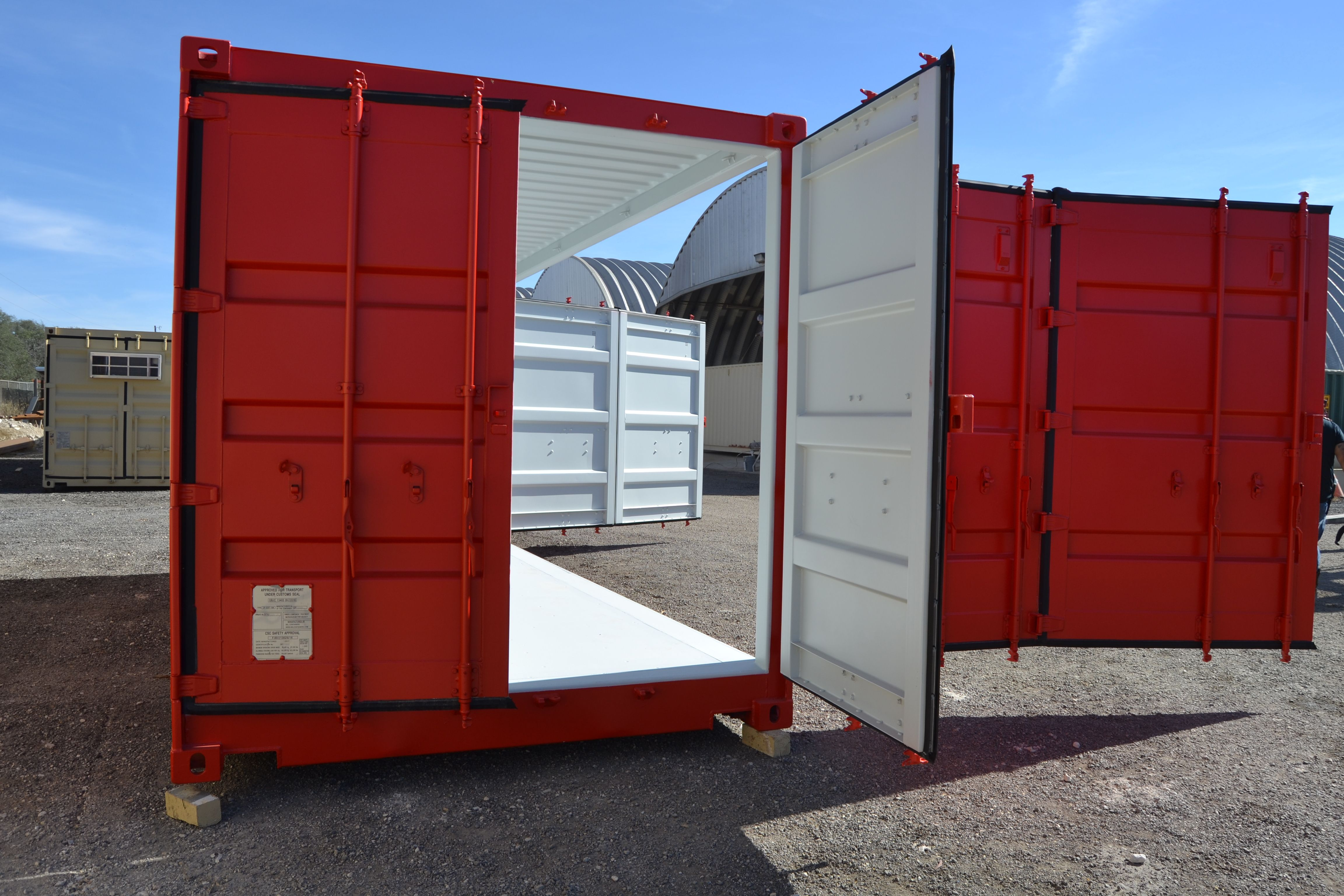 Cargo doors and side doors open on an open-side shipping