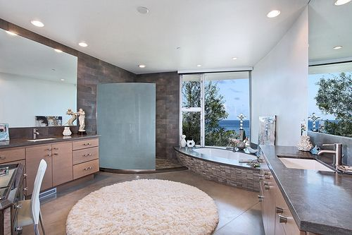 This beautiful bathroom remodel is nice and open for ease of movement on those busy mornings. #bathroomremodel #frostedglass #alcoveshower www.budgetbathandkitchen.com