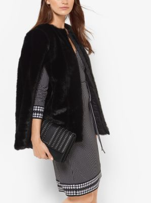 With its swingy silhouette and plush faux-fur craftsmanship, this chic cape makes an effortlessly elegant statement. Wear it with everything from graphic-print dresses to simple separates.