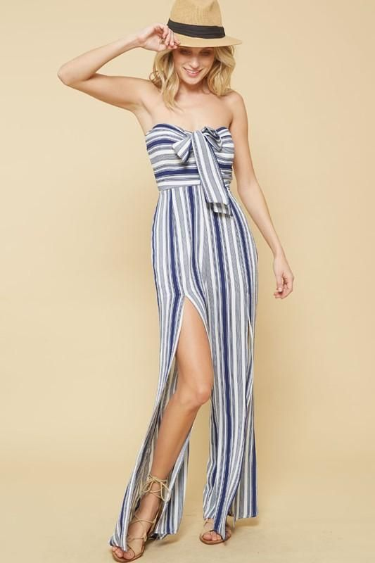 0b06f113d4e8 A striped strapless jumpsuit featuring elasticized sweetheart neckline with  self-tie front
