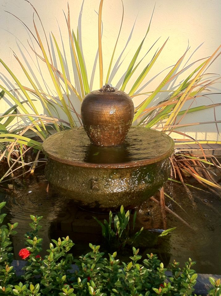 Small Golden Colored Urn Fountain With