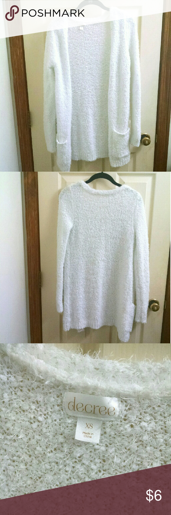 Fuzzy Sweater Fuzzy, white cover up sweater with pockets in the front. Brand - Decree, size - XS. 100% polyester. Gently used. Decree Sweaters