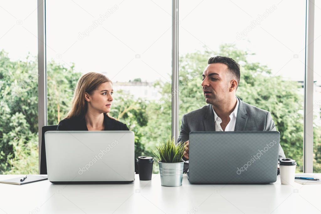 Businessman And Businesswoman Working In Office Stock Photo