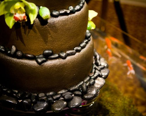 Brown wedding cake - Asian zen with river rocks, orchids and koi pond.  @Janet Rosebeary