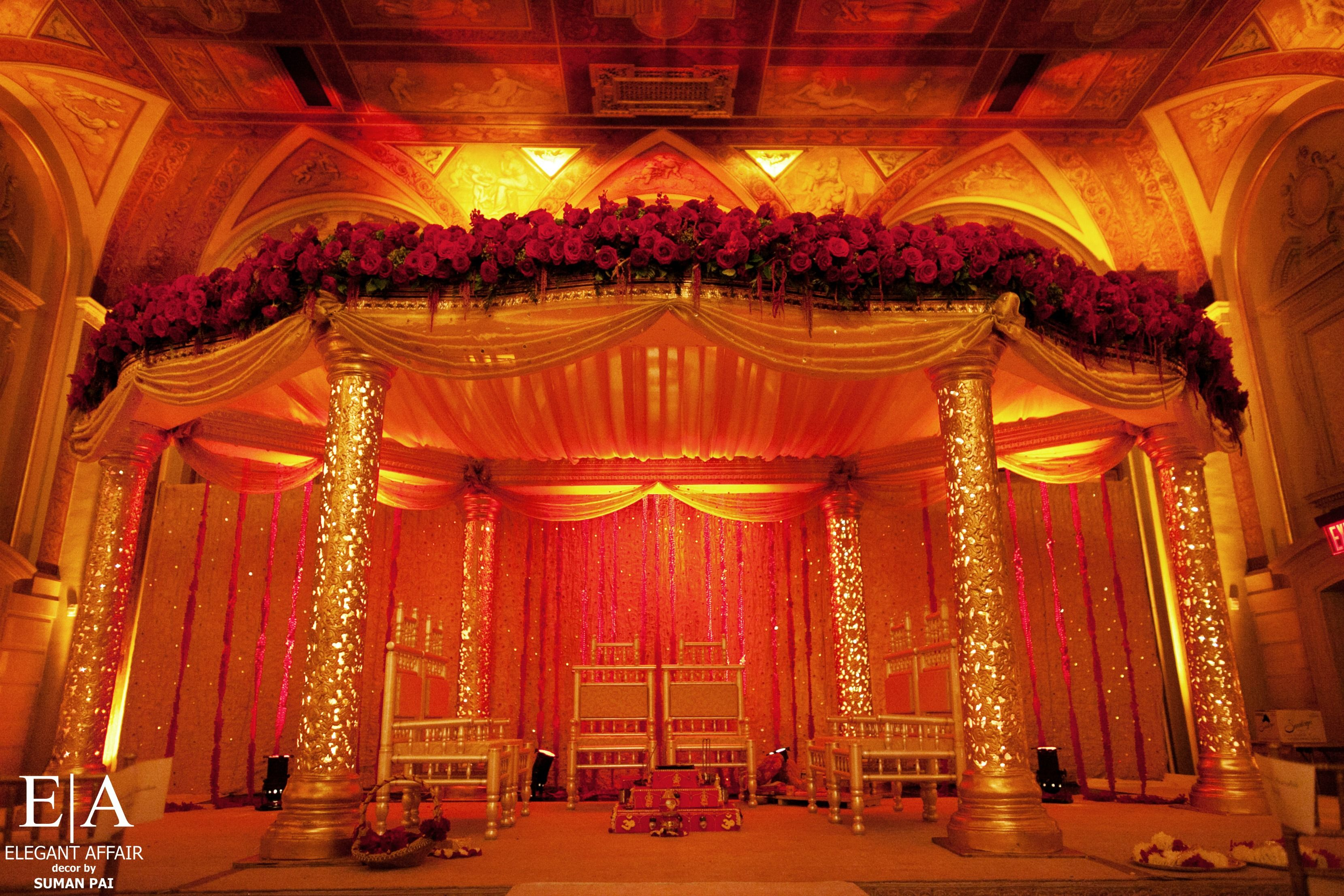 oval mandap, gold lighted pilars, red floral panel, canopy ceiling