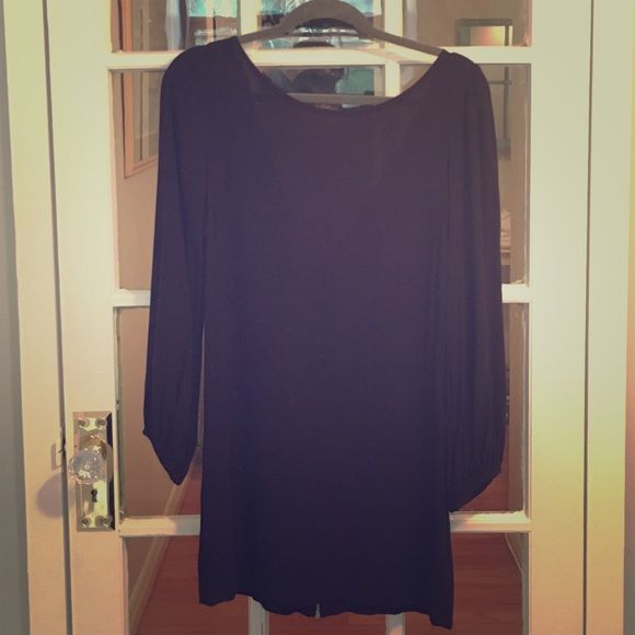 Long Black Bell Sleeve Nasty Gal dress Black bell sleeve rayon Nasty Gal dress. Has a zipper running down the entire back and the back has a lower v cut. Very cute LBD for summer. Tiny tiny bleach stain in the from right above the right thigh. Tried to take a picture of it but you can't even see it in the picture. Nasty Gal Dresses Long Sleeve