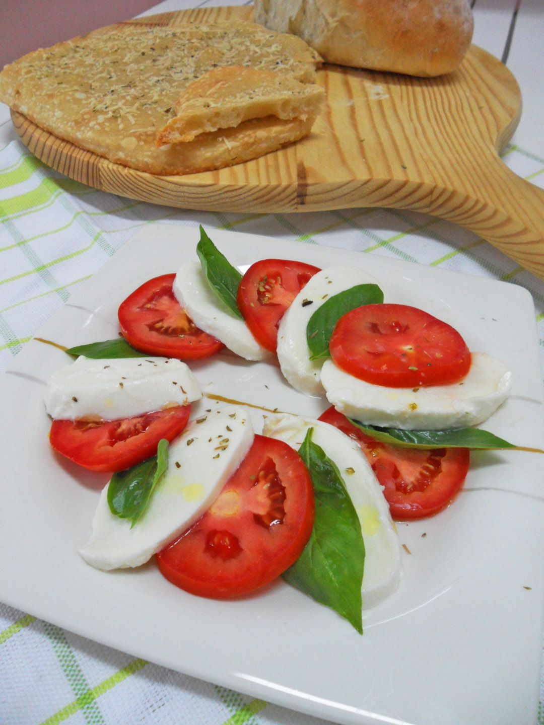 Caprese salad..... fresh mozzarella, tomato, basil, olive oil, salt, gorund black pepper, oregano