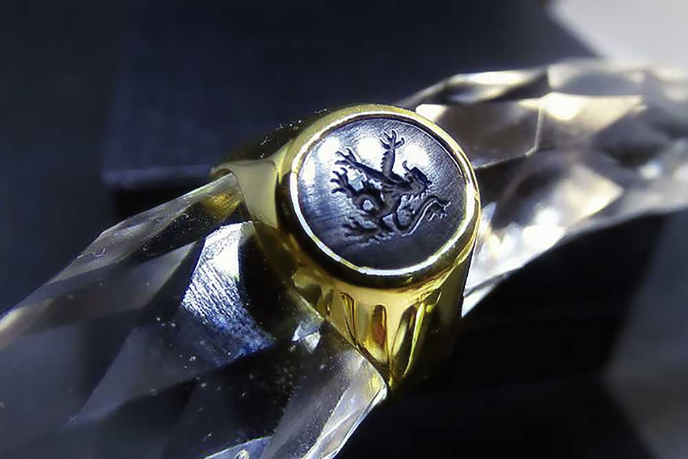 Gold Lion Signet Ring A gold lion signet ring hand engraved with this favourite heraldic design. Set to a solid 14kt gold body. Only 12 x 10 mm so very wearable by men, women and smaller hands.  -