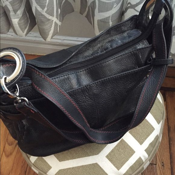 Slate grey cowhide leather shoulder bag Gorgeous, impeccable quality cowhide leather shoulder bag , beautiful rare slate grey By Ecco, excellent condition, lining intact but shows minimal signs of maybe spilled compact Ecco Bags Shoulder Bags