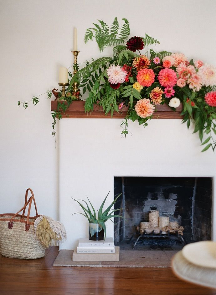 dramatic fireplace mantel flowers floral arrangement