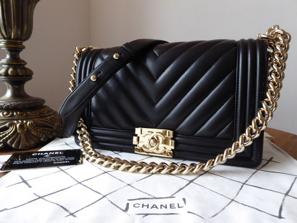 59c53e8cedc1 Chanel Old Medium Boy Chevron Black Lambskin with Champagne Gold Hardware  Crafted from beautifully soft lambskin