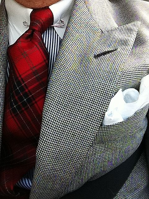 Plaid tie, striped shirt, collar pin and a pocket square.  It takes a lot of work to make your style look effortless.