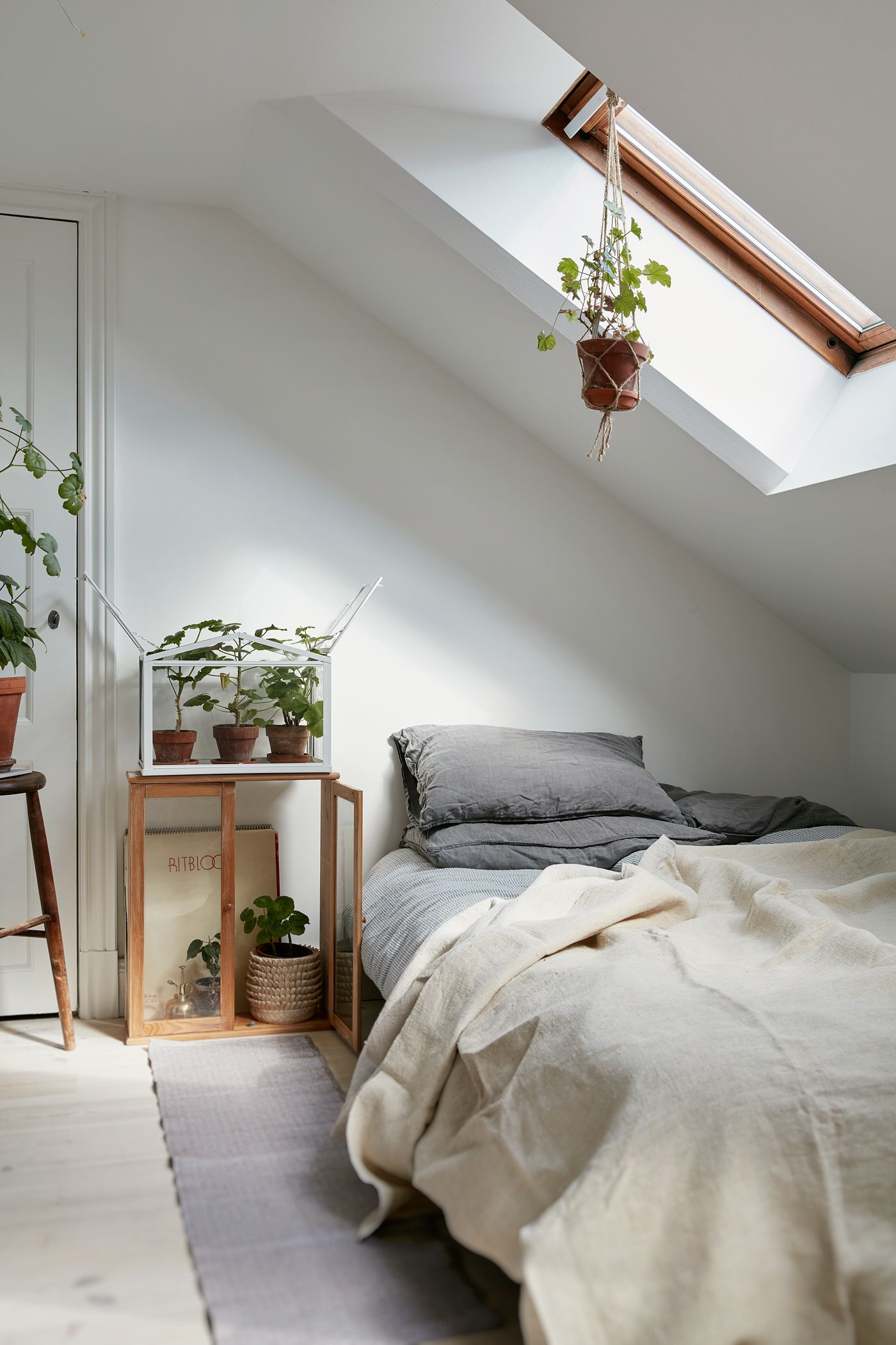 Attic bedroom in a Charming Plant-Filled Attic Apartment In Sweden - Gravity Home