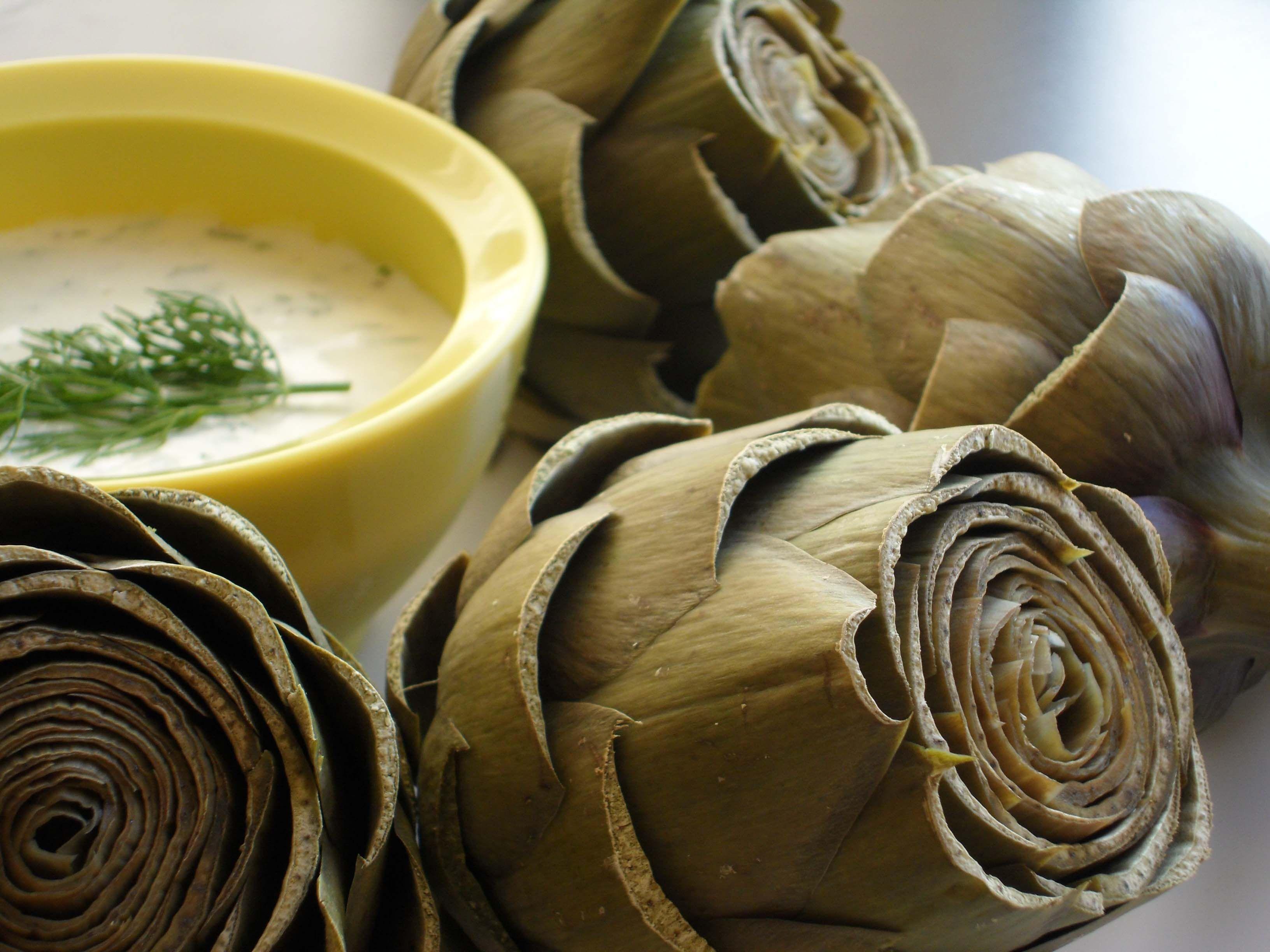 steamed artichoke with lemon dill sauce.